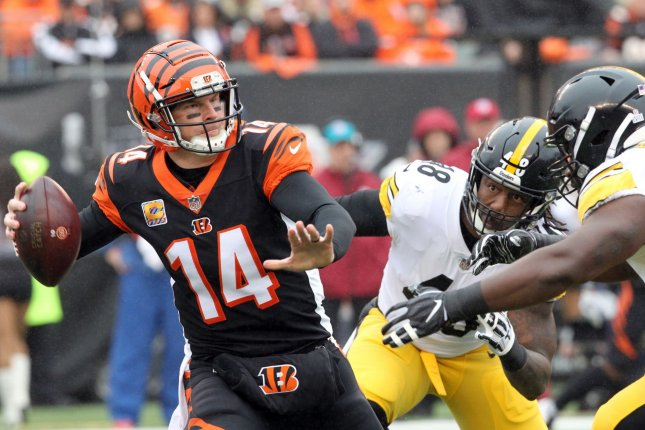 Cincinnati Bengals quarterback Andy Dalton (14) throws while under pressure from the Pittsburgh Steelers defense during the first half of play on October 14 at Paul Brown Stadium in Cincinnati. Photo by John Sommers II/UPI