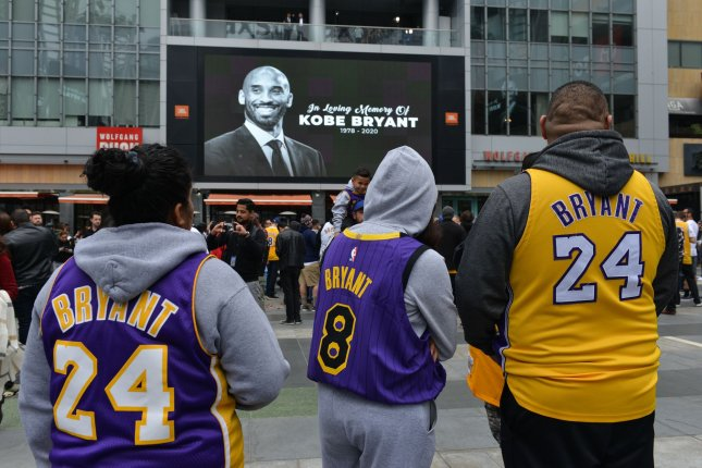 Fans attend a makeshift memorial to Los Angeles Lakers star Kobe Bryant at Staples Center in Los Angeles on Sunday. Photo by Christine Chew/UPI