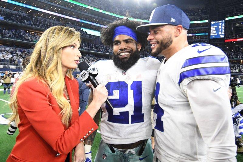 Dallas Cowboys running back Ezekiel Elliott (21) and Dak Prescott (R) both attended a gathering Friday at Prescott's Prosper, Texas, home. File Photo by Ian Halperin/UPI