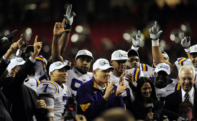 LSU Coach Les Miles, center, leads his players in celebration after the Tigers defeated Georgia 42-10 in the SEC title game in Atlanta Dec. 3, 2011. Top-ranked LSU will play No. 2 Alabama in the BCS championship game. UPI/David Tulis