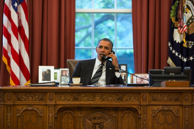 In this official photograph by the White House, United States President Barack Obama talks with Iranian President Hassan Rouhani during a phone call in the Oval Office at the White House in Washington, DC on September 27, 2013. This marked the first conversation of the leaders of both countries in 30 years. The two agreed to defuse the dispute over Iran's nuclear program. UPI