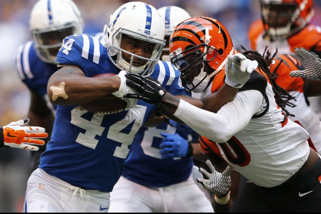 Indianapolis Colts running back Ahmad Bradshaw (44) fights to break free from Cincinnati Bengals' Reggis Nelson (20) during the first half of play at Lucas Oil Stadium in Indianapolis, Indiana, October 19, 2014. UPI/John Sommers II