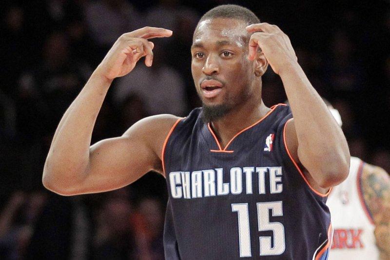 Charlotte Hornets guard Kemba Walker reacts after making a basket. File photo by John Angelillo/UPI