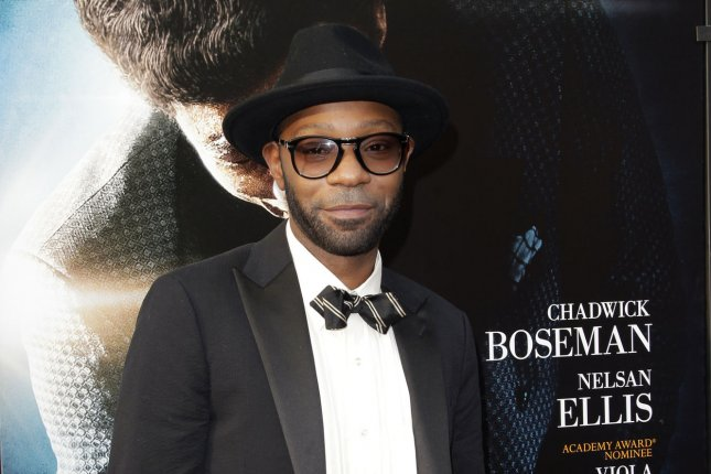 Nelsan Ellis arrives on the red carpet at the world premiere of Get On Up in New York City on July 21, 2014. The actor's manager said Saturday he has died at the age of 39. File Photo by John Angelillo/UPI
