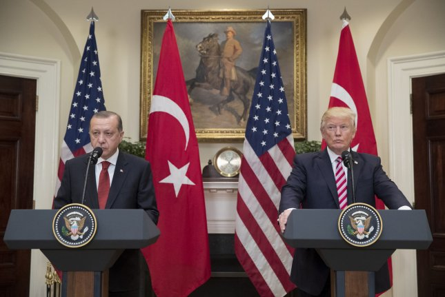 Turkish President Recep Tayyip Erdogan (L) and U.S. President Donald Trump deliver joint statements in the Roosevelt Room of the White House in 2017. On Saturday, a spokesman for Erdogan said in a news column the two countries' relationship can be saved if the United States addresses Turkey's security concerns. Photo by Michael Reynolds/UPI