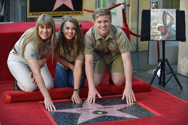 Bindi Irwin (C), pictured with Terri Irwin (L) and Robert Irwin, shared a promo and premiere date Tuesday for Crikey! It's the Irwins. File Photo by Christine Chew/UPI