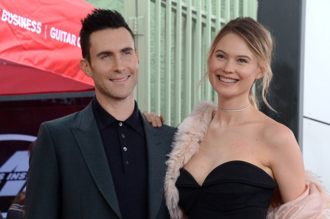 Adam Levine (L), pictured with Behati Prinsloo, is leaving The Voice after 16 seasons. File Photo by Jim Ruymen/UPI