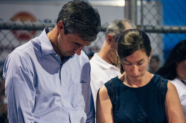 Democratic presidential candidate Beto O'Rourke and his wife Amy pray in El Paso, Texas, on August 4 at an interfaith vigil held to remember more than 20 people who were killed in a shooting attack the previous day. Photo by Justin Hamel/UPI
