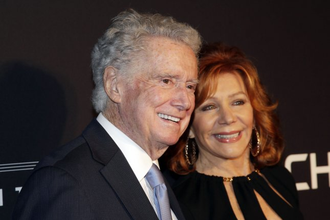Regis Philbin (L) and his wife Joy Philbin arrive at the New York Spring Spectacular opening night in New York City on March 26, 2015. His family announced Saturday that the longtime television personality died at the age of 88. File Photo by John Angelillo/UPI