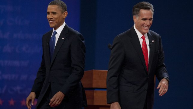 President Barack Obama (L) and Republican Presidential nominee Mitt Romney walk to their wives after shaking hands after the first Presidential debate at the University of Denver's Ritchie Center on October 3, 2012 in Denver. UPI/Gary C. Caskey