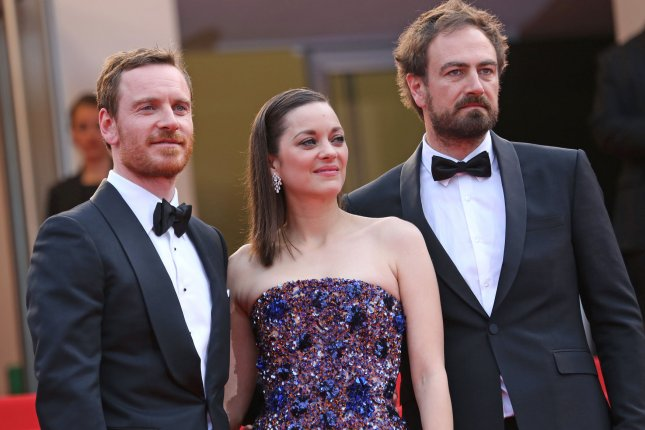 Michael Fassbender (L) with Marion Cotillard and 'Macbeth' director Justin Kurzel (R) at the Cannes International Film Festival on May 23. The actor and actress star in new 'Macbeth' character posters. File photo by David Silpa/UPI