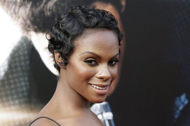Tika Sumpter arrives on the red carpet at the world premiere of Get On Up on July 21, 2014. Sumpter said on social media that her mother was arrested in North Carolina for having a $10 late fee for an overdue library book. File Photo by John Angelillo/UPI