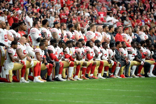 Some members of the San Francisco 49ers' kneel while others stand during the national anthem before a game against the Arizona Cardinals at University of Phoenix Stadium in Glendale, Arizona, Sunday, October 1, 2017. File Photo by Art Foxall/UPI