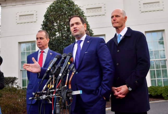 A delegation of Florida Republicans including Sen. Marco Rubio, Rep. Mario Rafael Diaz-Balart,and Sen. Rick Scott visited the White House Tuesday to discuss Venezuela's leadership. Photo by Kevin Dietsch/UPI
