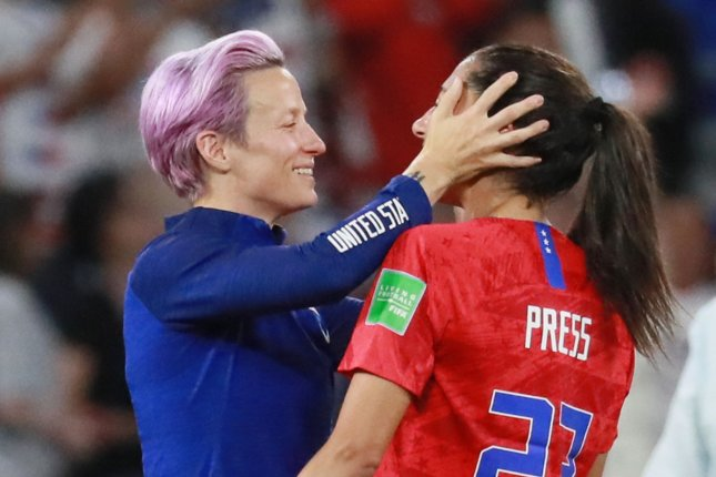 Megan Rapinoe (L) celebrates with teammate Christen Press after the 2019 FIFA Women's World Cup semifinal match against England on Tuesday at the Stade de Lyon in Lyon, France. The U.S. defeated England 2-1. Photo by David Silpa/UPI
