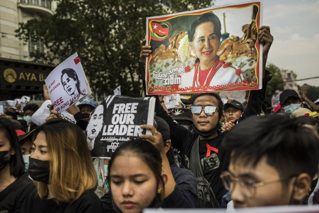 Activists hold a photo of deposed leader Aung San Suu Kyi during a protest in Yangon, Myanmar, on February 8, a week after she was overthrown by the nation's military in a coup. File Photo by Xiao Long/UPI