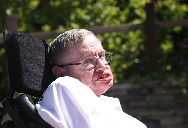 British physicist Stephen Hawking, who turns 70 Sunday, says some things remain a mystery to him -- especially women. He is pictured at the 2010 Chelsea Flower Show in London. UPI/Hugo Philpott