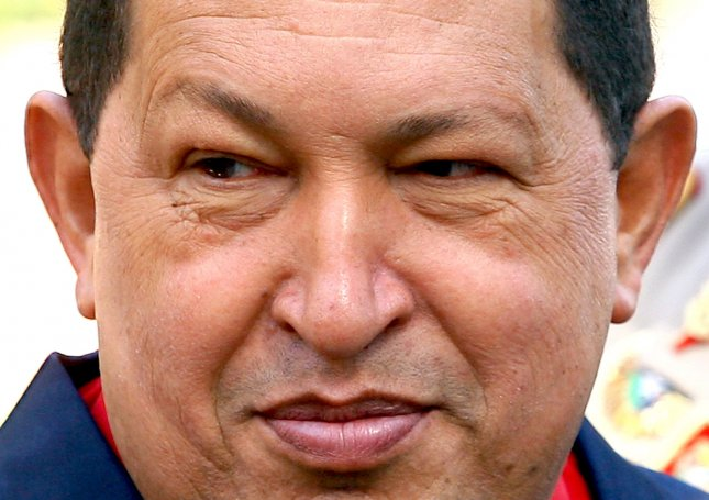 Venezuela's President Hugo Chavez, seen in this October 19, 2010 file photo in Iran, died March 4, 2013 after a two-year battle with cancer, ending his 14-year rule of the country. In the year since taking office, President Nicolas Maduro as seena 56 percent rise in inflation, food shortages and growing opposition. UPI/Maryam Rahmanian/File Photo