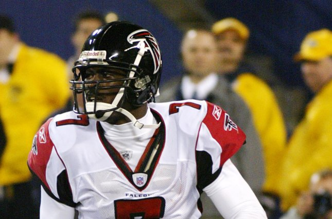 2869dce32 Former Atlanta Falcons quarterback Michael Vick scrambles for a first down in  the 4th quarter. The Atlanta Falcons defeated the New York Giants 14-10 at  ...