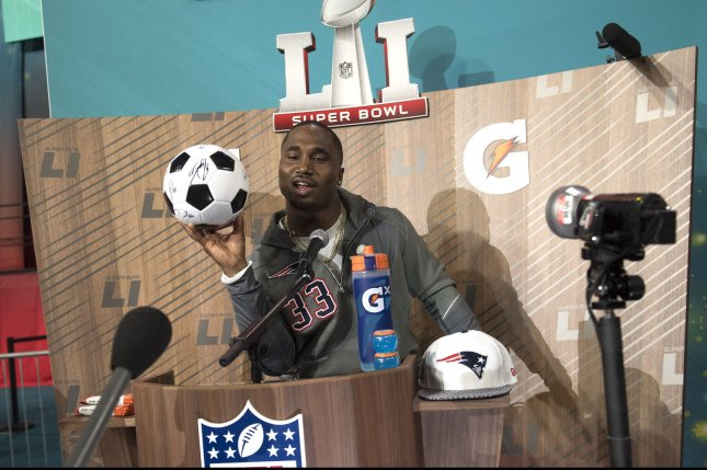 New England Patriots running back Dion Lewis holds a soccer ball after signing it for a member of the media during during Super Bowl LI Opening Night on January 30 at Minute Maid Park in Houston, Texas. Photo by Kevin Dietsch/UPI