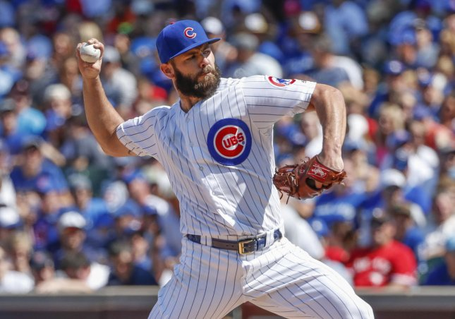 Chicago Cubs pitcher Jake Arrieta delivers against the Toronto Blue Jays in the fourth inning at Wrigley Field on Friday. Photo by Kamil Krzaczynski/UPI