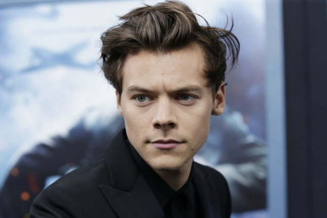 Harry Styles' followers reacted with disgust after a person grabbed the star's crotch during a concert Saturday. File Photo by John Angelillo/UPI