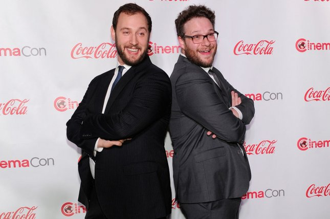 Evan Goldberg (L) and Seth Rogen are executive producing a limited series based on non-fiction novel Console Wars. File Photo by David Becker/UPI