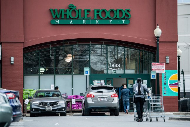 Customers walk into a Whole Foods Market store in Silver Spring, Md., on March 31. Maryland Gov. Larry Hogan announced Wednesday the state's stay-at-home order would expire Friday, allowing retail stores to reopen at limited capacity. Photo by Kevin Dietsch/UPI
