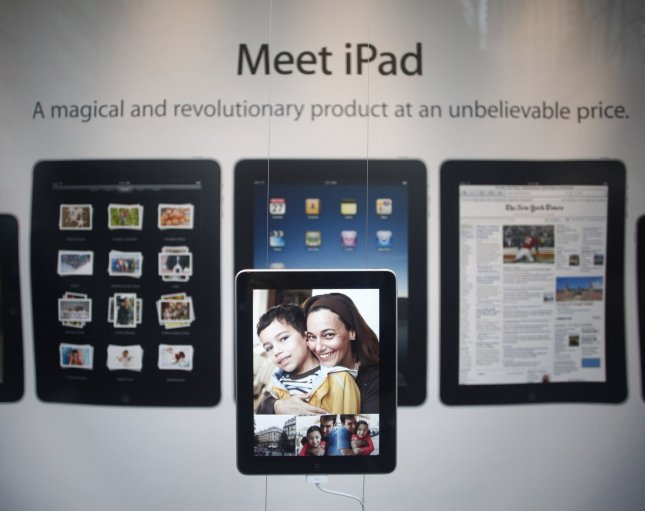 A display advertises the iPad in the window of Apple Computer's North Michigan Avenue store in Chicago on April 3, 2010. Apple's new tablet device went on sale Saturday at the company's more than 200 retail outlets in the United States, as well as many Best Buy stores. UPI/Brian Kersey