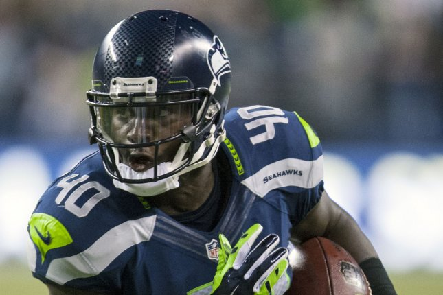 Former Seattle Seahawks fullback Derrick Coleman (40) runs for a touchdown after catching a 15-yard pass from quarterback Russell Wilson against the Green Bay Packers in the fourth quarter on September 4, 2014 at CenturyLink Field in Seattle. File photo by Jim Bryant/UPI