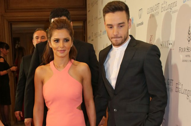 Liam Payne (R) pictured here with Cheryl Cole. Payne announced on Twitter that he and Cole are splitting up. File Photo by David Silpa/UPI.