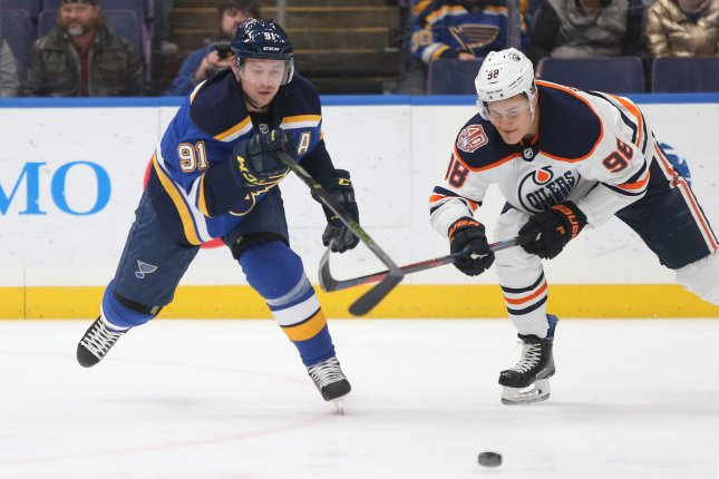 St. Louis Blues forward Vladimir Tarasenko fights for the puck with Edmonton Oilers winger Jesse Puljujarvi (R) in the first period at the Enterprise Center on December 5 in St. Louis. Photo by Bill Greenblatt/UPI