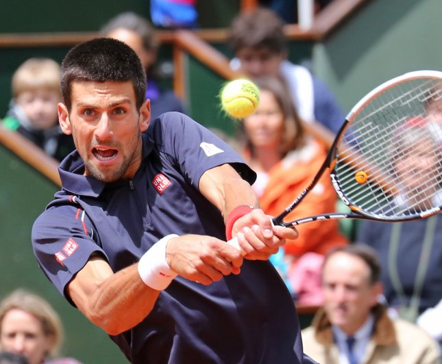 Novak Djokovic, shown during the French Open final earlier this month, posted a straight-set win Monday as he opened defense of his 2011 Wimbledon championship. UPI/David Silpa
