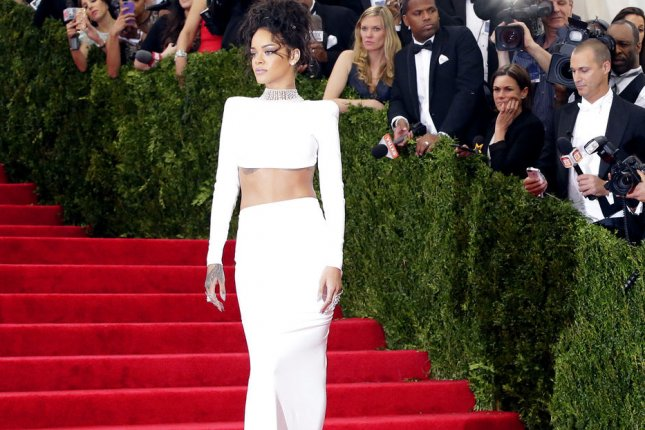 Rihanna arrive on the red carpet at the Costume Institute Benefit celebrating the opening of Charles James: Beyond Fashion and the new Anna Wintour Costume Center at the Metropolitan Museum of Art in New York City on May 5, 2014. UPI/John Angelillo