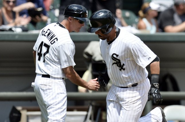 Chicago White Sox third base coach Joe McEwing (L) congratulates Geovany Soto. Photo by Brian Kersey/UPI
