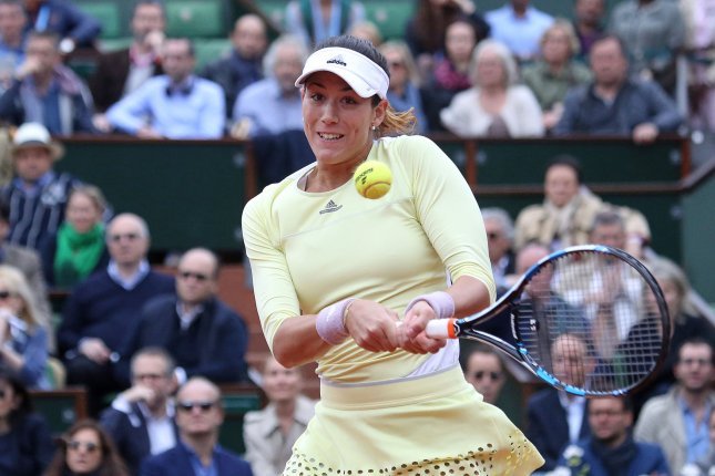 Garbine Muguruza of Spain hits a shot during her French Open women's final match against American Serena Williams at Roland Garros in Paris on June 4, 2016. Muguruza defeated Williams 7-5, 6-4 to win her first French Open Championship. Photo by David Silpa/UPI
