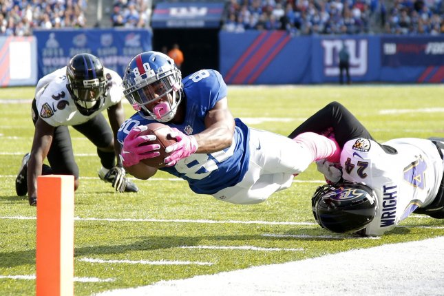New York Giants Victor Cruz dives for the end zone last season. Cruz signed with the Bears in the off-season and is trying to come back after injury cost him most of the past two years. File photo by John Angelillo/UPI
