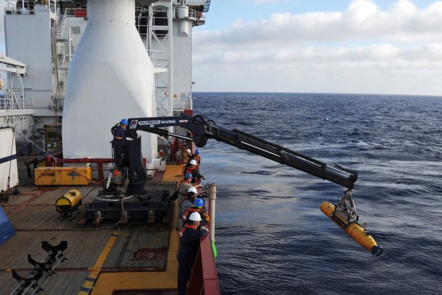 Operators aboard the Australian Defense Vessel Ocean Shield move the U.S. Navy's Bluefin-21 autonomous underwater vehicle in the Indian Ocean to search for missing Malaysia Airlines Flight MH370 in 2014. File Photo by Peter D. Blair/U.S. Navy/UPI