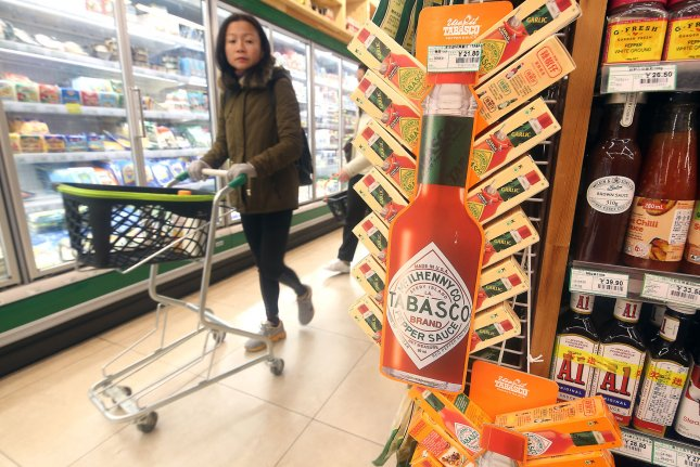 Made In U.S.A brands and products are sold at an upscale supermarket in Beijing, China, on November 27. An ongoing trade conflict between China and the U.S. was a reason the IMF downgraded its economic growth forecast Tuesday. Photo by Stephen Shaver/UPI