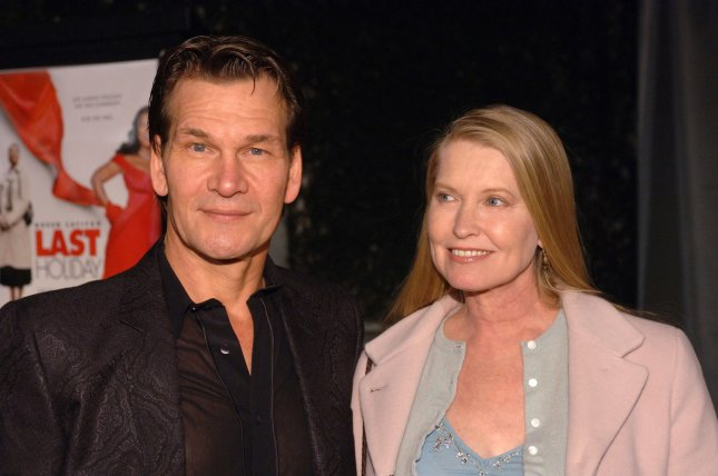 Actor Patrick Swayze (L) and wife Lisa Niemi attend the premiere of 'Last Holiday' at the Cinerama Dome in Hollywood January 12, 2006 . (UPI Photo/ Phil McCarten).