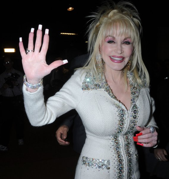 Tony nominee, in the Best Original Score category, Dolly Parton arrives to pick up her 2009 Tony nomination certificate at the nominee luncheon on May 6, 2009. (UPI Photo/Ezio Petersen)