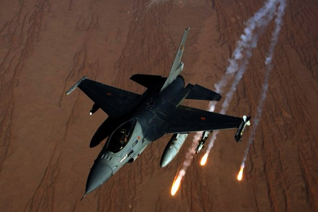 A Belgian Armed Forces F-16 Fighting Falcon aircraft releases flares near Kandahar Airfield, Kandahar province, Afghanistan, Oct. 7, 2013. UPI/ Sgt. Antony Lee/DoD