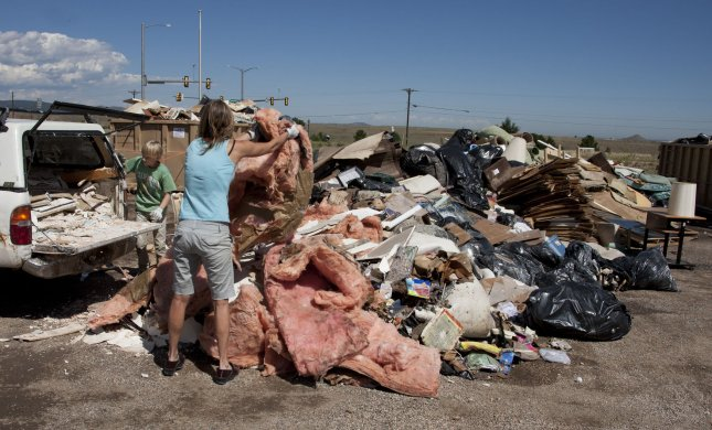 Disaster Distress Helpline helps those cope following disaster. Boulder residents dump water damaged belongings at one of 12 dump sites around the city during the aftermath of flooding following epic rainstorms in Boulder, Colo on September 17, 2013.. UPI/Gary C. Caskey