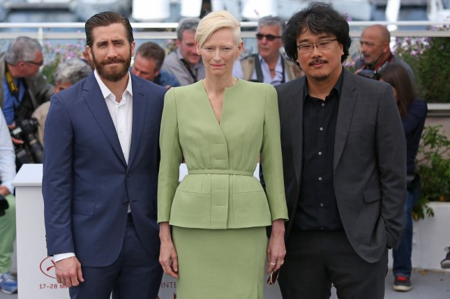 Jake Gyllenhaal, Tilda Swinton and Bong Joon-ho (L-R) attend a Cannes International Film Festival photocall for Okja on Friday. Photo by David Silpa/UPI