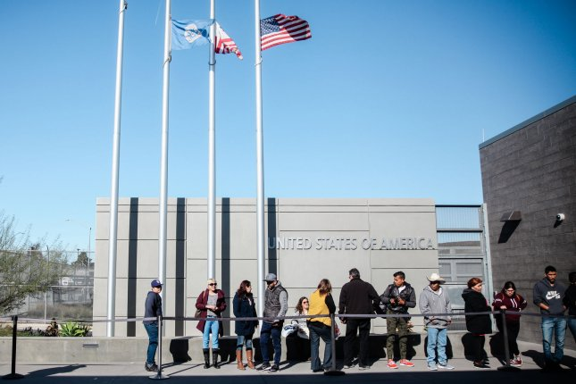 People stand in line at the Port of Entry in San Ysidro, Calif., on December 29. Last week, U.S. Customs and Border Protection began returning asylum seekers to Mexico through San Ysidro to wait for immigration court dates. File Photo by Ariana Drehsler/UPI