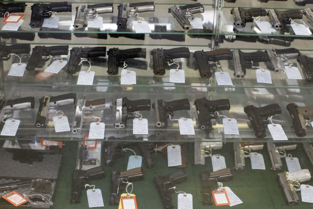 Various semiautomatic handguns are displayed in a case at G. A. T. Guns in Dundee, Illinois. Background checks for firearm sales were among the highest on record in April, FBI figures show. File Photo by Brian Kersey/UPI
