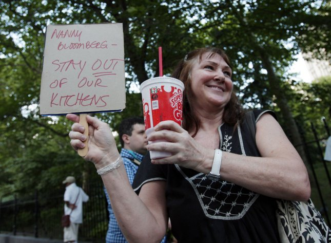 Soda, meth or crack cause about the same damage to teeth/ Protesters hold up signs at the Million Big Gulp March protest organized by the group NYC Liberty, City Council members and other demonstrators to express opposition to Mayor Michael R. Bloomberg's proposal to prohibit licensed food service establishments from using containers larger than 16 ounces to serve high-calorie drinks at City Hall Park in New York City on July 9, 2012. UPI/John Angelillo