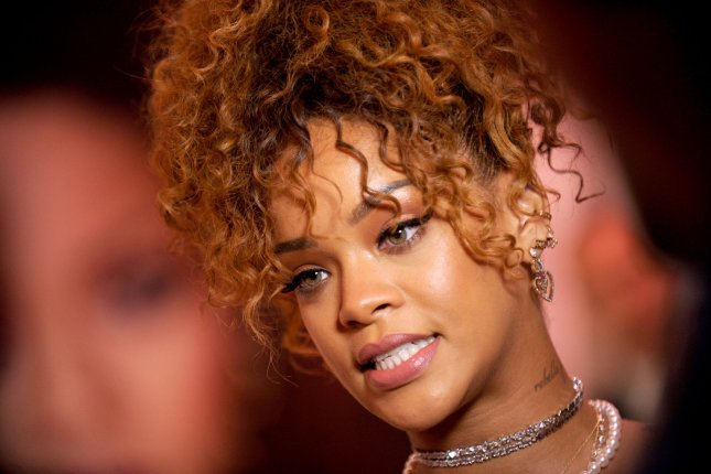 Singer Rihanna arrives for the RiRi by Rihanna fragrance unveiling at Macy's Downtown Brooklyn in New York City on Aug. 31, 2015. The singer says she and Taylor Swift are too different to be on the same stage. She's a role model, Rihanna said. I'm completely not. Photo by Dennis Van Tine/UPI