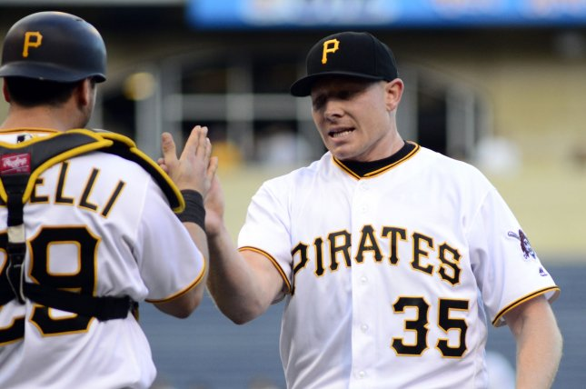 Pittsburgh Pirates catcher Francisco Cervelli (29) greets Pittsburgh Pirates relief pitcher Mark Melancon (35) at the mounds after the 3-1 Pirates win against the New York Mets in the first game of the doubleheader at PNC Park on June 7, 2016 in Pittsburgh. Photo by Archie Carpenter/UPI