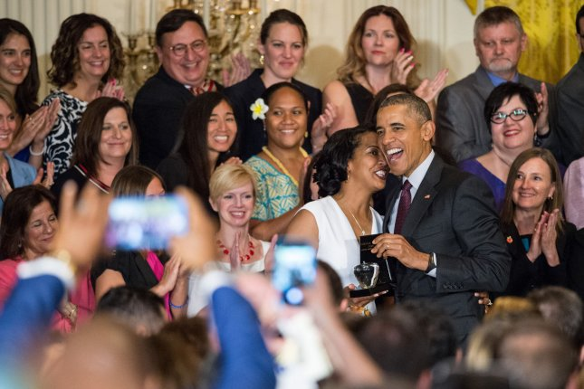 President Barack Obama honors Jahana Hayes for being named the 2016 National Teacher of the Year in the East Room of the White House on May 3. An education think tank on Thursday released a 100-page report that warned of a looming teacher shortage in the United States -- largely, it says, due to high annual rates of attrition and the residual effects of the Great Recession that forced education officials nationwide to make economic cuts. File Photo by Ken Cedeno/UPI